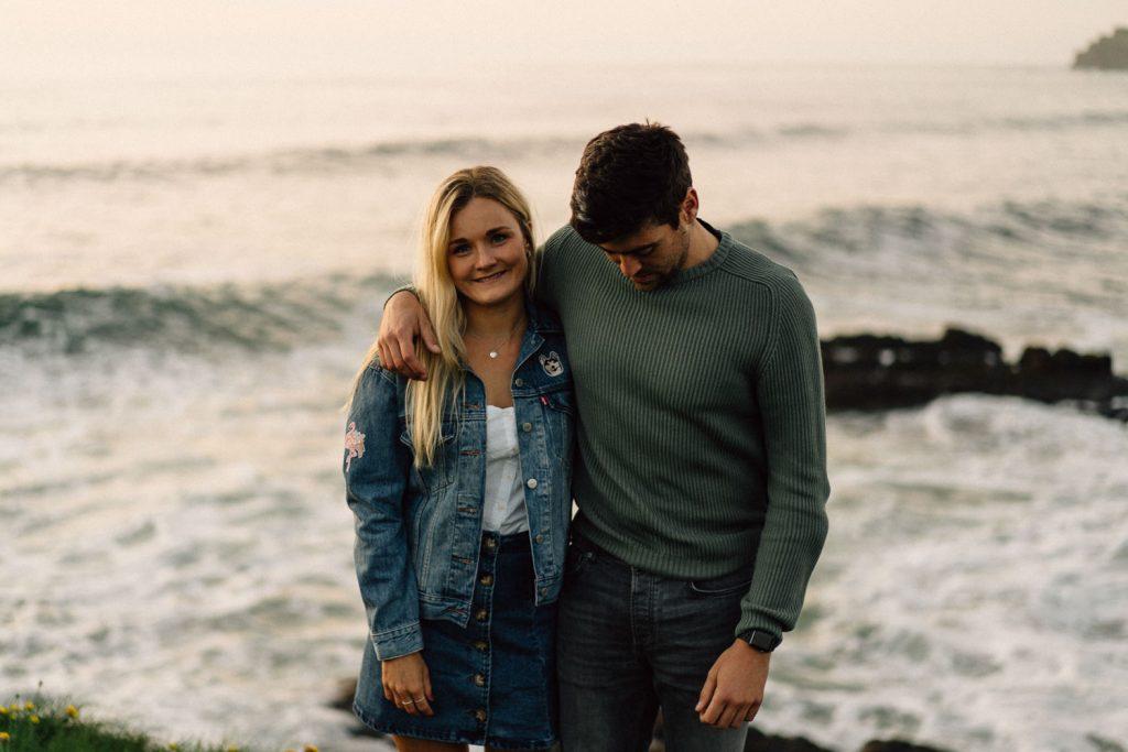 couple posing for photo at sunset Atlantic Ocean Northern Ireland Wedding & Engagement Photographer