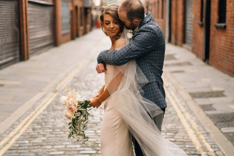 groom kissing bride Belfast Wedding Merchant Hotel Photos